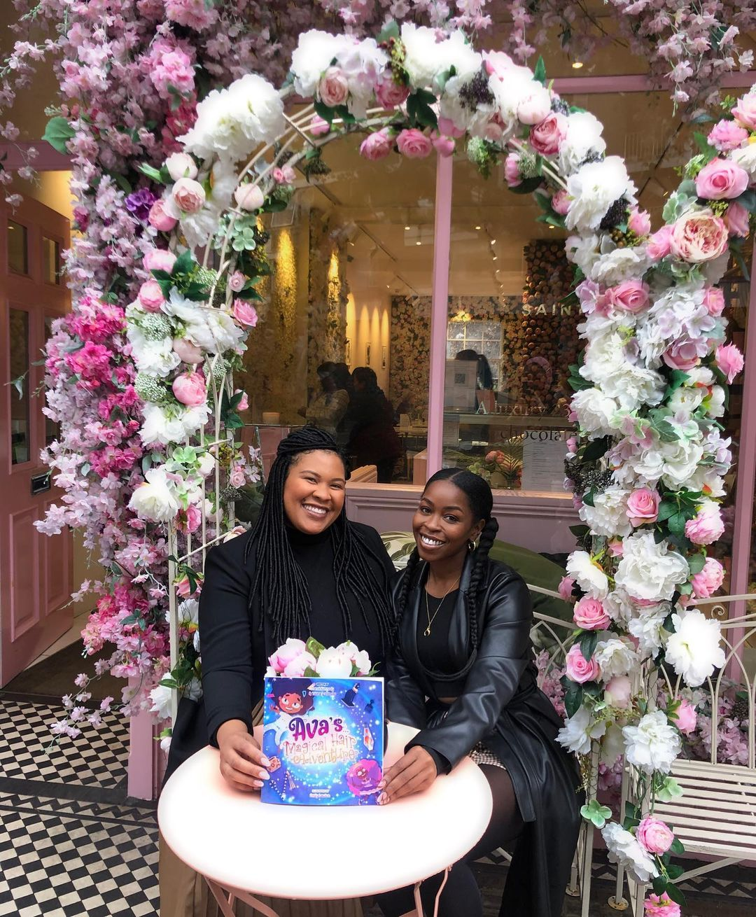 Authors Chanel and Telena with the book